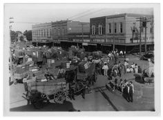 Wagons full of cotton (?), Downtown Arlington, Texas early 1900's