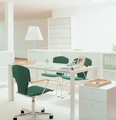 Calm green and white workspace, with the Egoa Task Chair.