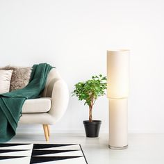 Floor textile lamp with a chrome-colored base. Floor Chair, Floor Lamp, Chrome Colour, Chrome Plating, Lighting Design, Flooring, Table, Furniture, Color