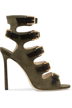 Jimmy Choo's 'Trick' sandals have five black leather straps that create a flattering, foot-hugging silhouette. This army-green suede pair is set on a towering stiletto heel - a feminine detail that offsets the tough-luxe look. Each polished gold buckle is subtly embossed with the designer's emblem.