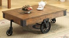 Industrial Coffee Table: Enjoy a drink with friends while sitting around this unique cocktail table. Its funky design resembles a cart from an old factory, complete with weathered wood and metal wheels, and the table is durable enough for use as a coffee ...Read More @ http://greateststuffonearth.com/industrial-coffee-table/