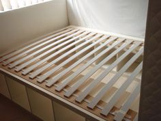 Expedit re-purposed as bed frame for maximum storage - IKEA Hackers