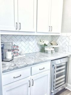 The backsplash is Daltile m313 contempo white marble 3×6 tile laid on herringbone.