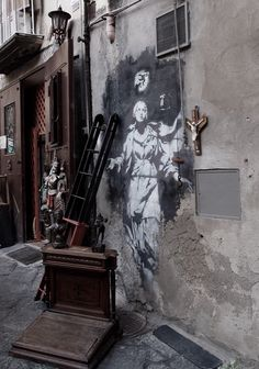 Naples, One of the two graffiti left by Banksy in town. Both have religious meanings. Italy