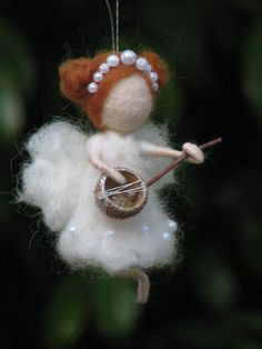 """Needle felted fairy idea ---I think I'll pin this to my """"Crafts"""" board as well. This would be a good idea for making angel ornaments for Christmas!"""