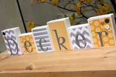 use scrapbook paper to mod podge onto blocks with baby name