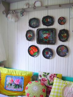 Vintage trays on the wall and piles of funky boho pillows