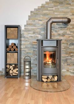Cleaning wood stove is essential to keep it safe and efficient in burning woods. Learn how to clean your wood stove properly with this guide. Stove Fireplace, Fireplace Design, Modern Fireplace, Fireplace Glass, Fireplace Hearth, Wood Pellet Stoves, Firewood Rack, Firewood Storage, Storage Racks