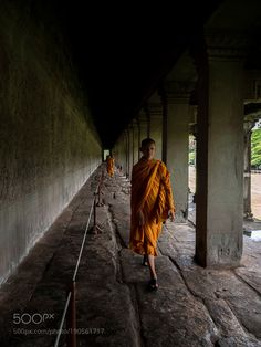 Popular on 500px : Young monk in Angkor Wat by anaolgagarcia