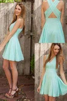 85794dba4 Mint blue short bridesmaid dress features V neckline falling into wide  straps