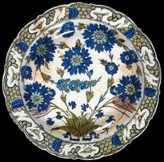 Dish with foliate rim Turkey, Isnik, c.1545-1555 Bequeathed by T.H. Riches in 1935; received in 1950 (C.23-1950, above right)