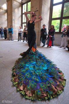 peacock design dress on a flamenco dancer