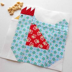"""""""Mama Hen"""" quilt block by Lori Holt.  I like this colorway, too."""