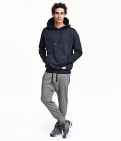 Sweatpants with a dropped gusset and tapered legs. Elasticized drawstring waistband, side pockets, one back pocket, and ribbed hems.