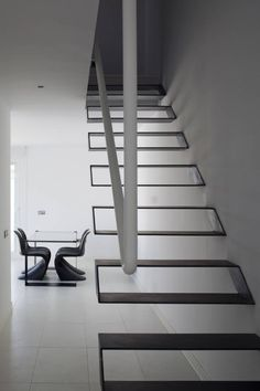 Minimal steel cantilevered stairs in Syntes House, Pinto, Spain // dosmasuno arquitectos, photo: Miguel de Guzmán