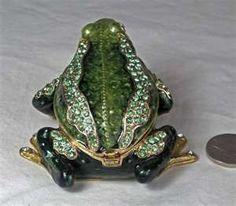 have here is a collectible hinged Frog Trinket Box.