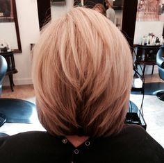 Beige blonde medium stacked haircut