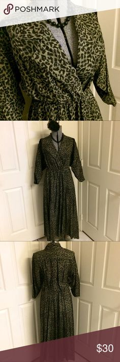 VINTAGE Leopard Dress Classic leopard print long-sleeved dress in EXCELLENT vintage condition! Elasticized waistband provides extra stretch beyond the 31 inch measurement. Total dress length: 51 inches. Total skirt length from waistband to bottom of dress: 33.5 inches. Beautiful dress with lovely movement in the full pleated skirt. Label shows size 15/16, but vintage tends to run small. May fit like a L/XL. VINTAGE Dresses Long Sleeve