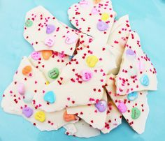 Conversation Heart Bark  - - -  White chocolate  Conversation hearts  Sprinkles    Melt the white chocolate in the microwave for about 30 seconds.  Remove and stir.  If not completely melted, microwave for another 30 seconds.  Spread onto a cookie sheet lined with aluminum foil.  Add conversation hearts and sprinkles to the chocolate.  Place in the fridge overnight.  Y-U-M!