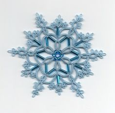 Lovely tatted snowflake with beads - from Le Blog de Frivole: Ice Queen