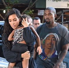 Precious cargo: Kim flashed her large diamond ring as she carried a sleeping North back into their AirBnB apartment