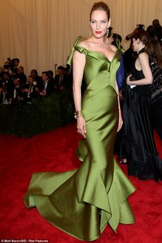 Green goddess: Uma Thurman, the 43-year-old actress in dramatic off-shoulder fishtail gown