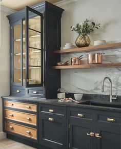 modern kitchen design with navy kitchen cabinets, black kitchen cabinets in modern farmhouse kitchen Dark Blue Kitchen Cabinets, Dark Blue Kitchens, Dark Cabinets, Black And Copper Kitchen, Kitchen Cabinetry, Soapstone Kitchen, Kitchen Cabinets Trends, Handles For Kitchen Cabinets, Timeless Kitchen Cabinets