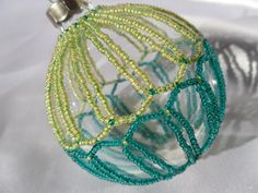Handmade Lime and Dark Green Glass Ornament with Beaded Netting