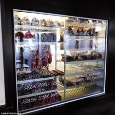 The steaks are displayed in a cabinet which is marked with how long they have been aged fo...
