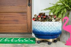 3 Oversized Planters You Can Make From Upcycled Items | HGTV Upcycled Crafts, Diy Upcycled Planters, Tire Planters, Basket Planters, Diy Crafts, Blue Spray Paint, Old Tires, Backyard Landscaping, Landscaping Ideas