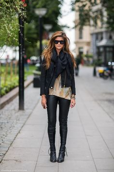 Faux leather pants, loose top, motorcycle jacket, boots, scarf