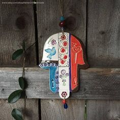 This beautiful one-of-a-kind hamsa was formed using high-fire stoneware, in the hand-built method, then textured, glazed with lead free various glazes and under glazes and high fired in my kiln at my studio. I added matching colored ceramic, glass and resin beads and a hemp cord for hanging. Ceramic hamsas by KerenOr Handmade on Etsy