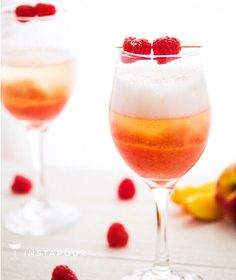 """#Bellini is a cute word meaning """"little beautiful"""" (things or people implied) in Italian...  & I couldn't agree more.  #25DaysOfDranksmas  ● NAME: Raspberry & Peach #Bellinis ● CREDITS: Sweet Peas and Saffron Blog ● DETAILS: Raspberry Simple Syrup, Frozen Peaches (Blended Slushy), #Prosecco  Instapour.com"""