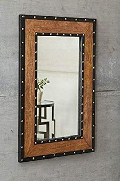 Made of burnt wood, Dulcina accent mirror's frame has a reclaimed yet rich vibe. The addition of black metal banding and antiqued gold rivets punctuates the industrial look. Industrial Wall Mirrors, Metal Mirror, Wall Mounted Mirror, Industrial Design Furniture, Metal Furniture, Metal Walls, Wood And Metal, Gold Wood, Black Metal