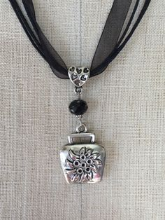 Stunning ribbon necklace with intricate alpine inspired cowbell charm and matching gem. This necklace can go perfectly with your dirndl or your everyday outfit! - Hand crafted necklace by Chicago base Ribbon Necklace, Locket Necklace, Pendant Necklace, Necklaces, Diamond Heart, Cowbell, Jewelry Crafts, Creative, Charmed