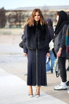 25 ways to wear a faux fur vest - over a black midi skirt or dress with long sleeves + white pointy toe heels