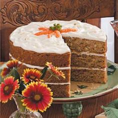 Coconut Carrot Cake Recipe -I found this recipe in a cookbook years ago. It's easy to make, and my family loves its moistness. It's impressive when prepared in three layers. -Shirley Braithewaite, Onaway, Alberta