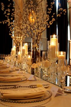 mirror table runners- rather be antiqued mirror covered in various leveled arrangements and candles