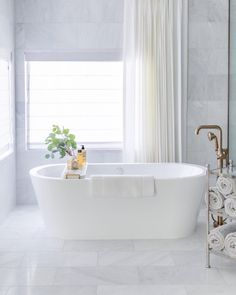 A timeless, tonal space inspires endless relaxation. Get the look at theshadestore.com. // Designed by House of Four Design Reno, Design Consultant, Clawfoot Bathtub, Winter White, Drapery, Window Treatments, Master Bathroom, Decorating Your Home, Household