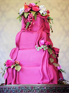 This deep cherise colored cake was designed to matched the bridesmaid's dresses, while the sugar flowers, leaves and berries reflected the centerpieces.