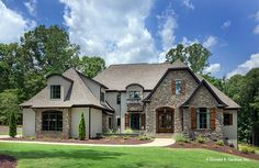 Plan of the Week over 2500 sq ft - The Carrera #1178! Stone and stucco combine to create an elegant European manor that calls upon the facades of long ago.