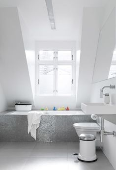The residents built a box around an ordinary glass fiber shell bathtub, then covered it in a mosaic of shower tiles.