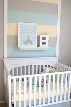 A break from the traditional primary color scheme for baby boys, we're fans of the softer, lighter, sweeter colors used in this nursery. Also, this room proves that you don't need to paint an entire wall in stripes in order to get the great effect - just highlight the area behind the crib for an adorable touch.   Could change up the colors for a baby girl <3 adorable!