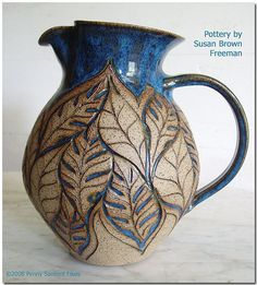 blue pitcher carved leaves  pottery ceramics clay