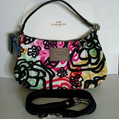 """COACH POPPY PURSE Coach Graphic Blossom Groovy convertible shoulder hobo bag #15590. Purse is in great condition with longer shoulder strap and hangtags. Inside and outside are clean. Canvas with inside zip and multifunction pockets.  Zip-top closure, fabric lining.  Outside zip pocket. Detachable 45"""" shoulder strap can be worn on shoulder or crossbody. Ask for more pictures if needed.  NO TRADES. Coach Bags Shoulder Bags"""