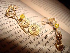 Golden swirls war cuff set by Anastasia Lecky: Gold & crystals