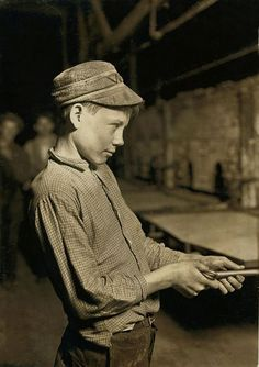 1908  Photo by Lewis Wickes Hine    15-year-old Carrying-in Boy at the Lehr Glass Works, Grafton, W. Va. Has worked for several years. Works nine hours. Day shift one week, night shift next week. Pay: $1.25 per day ($30.00/day 2010 dollars). Location: Grafton, West Virginia.
