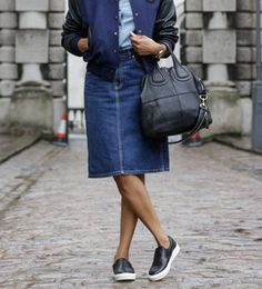 """Think """"Sporty Chic"""" - pair a denim skirt with with a bomber jacket and killer pair of slides."""