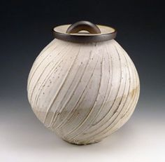 *Chris Staley Love the lines formed with slip.  Note stain on the lid.  Very nice