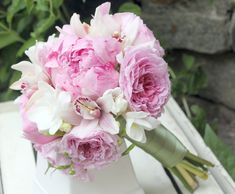 Another lovely bouquet of pink peonies, garden roses, cymbidium orchids and freesia.